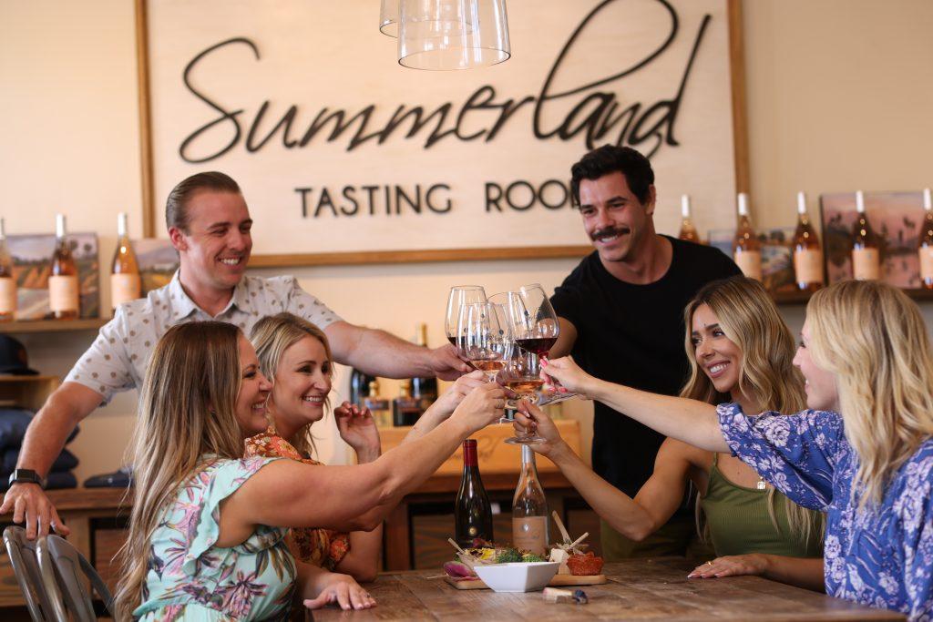 Guests enjoying wine tasting at Summerland Winery